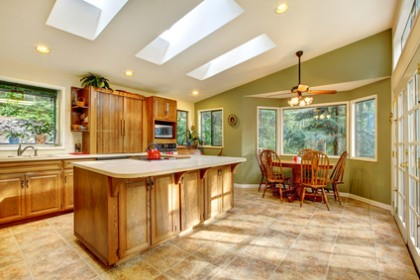 Large country kitchen with skylights.